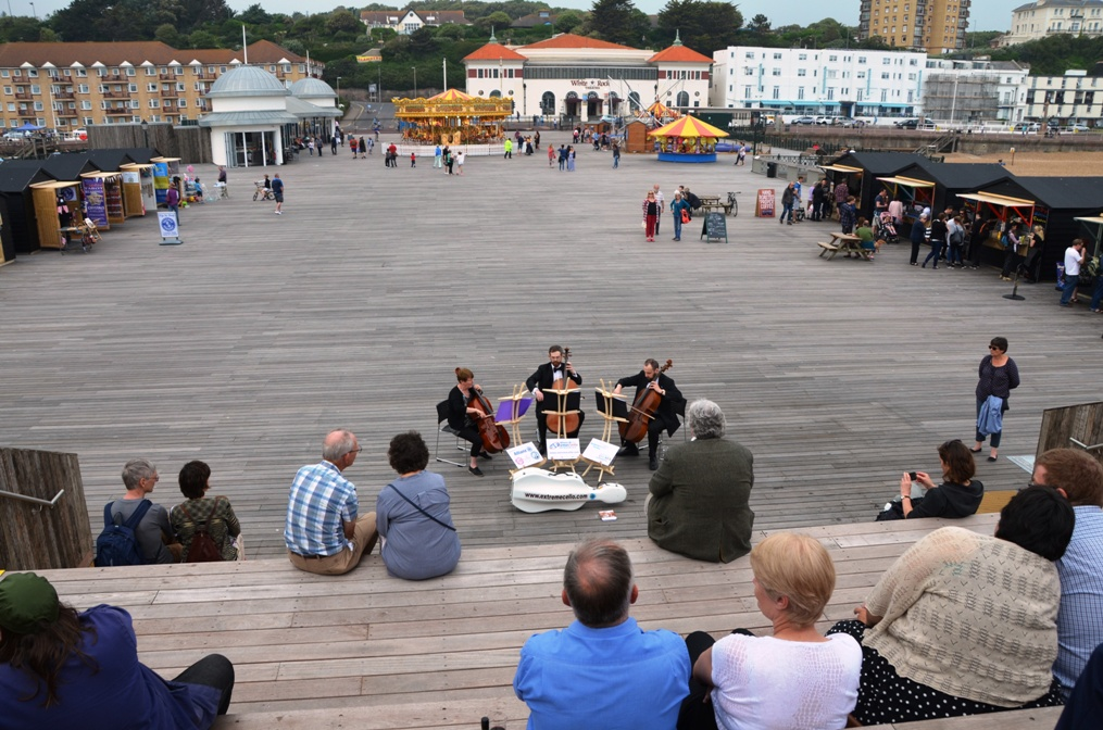 The Extreme Cello team accompany the tour of Hastings Pier, and draw quite a crowd! The NPS wish them all the best with their 'Pier Pressure' challenge!