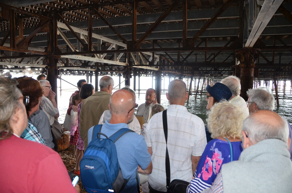 National Piers Society Members enjoy an 'under the pier' tour of Hastings Pier led by Steve Pike and David Spooner